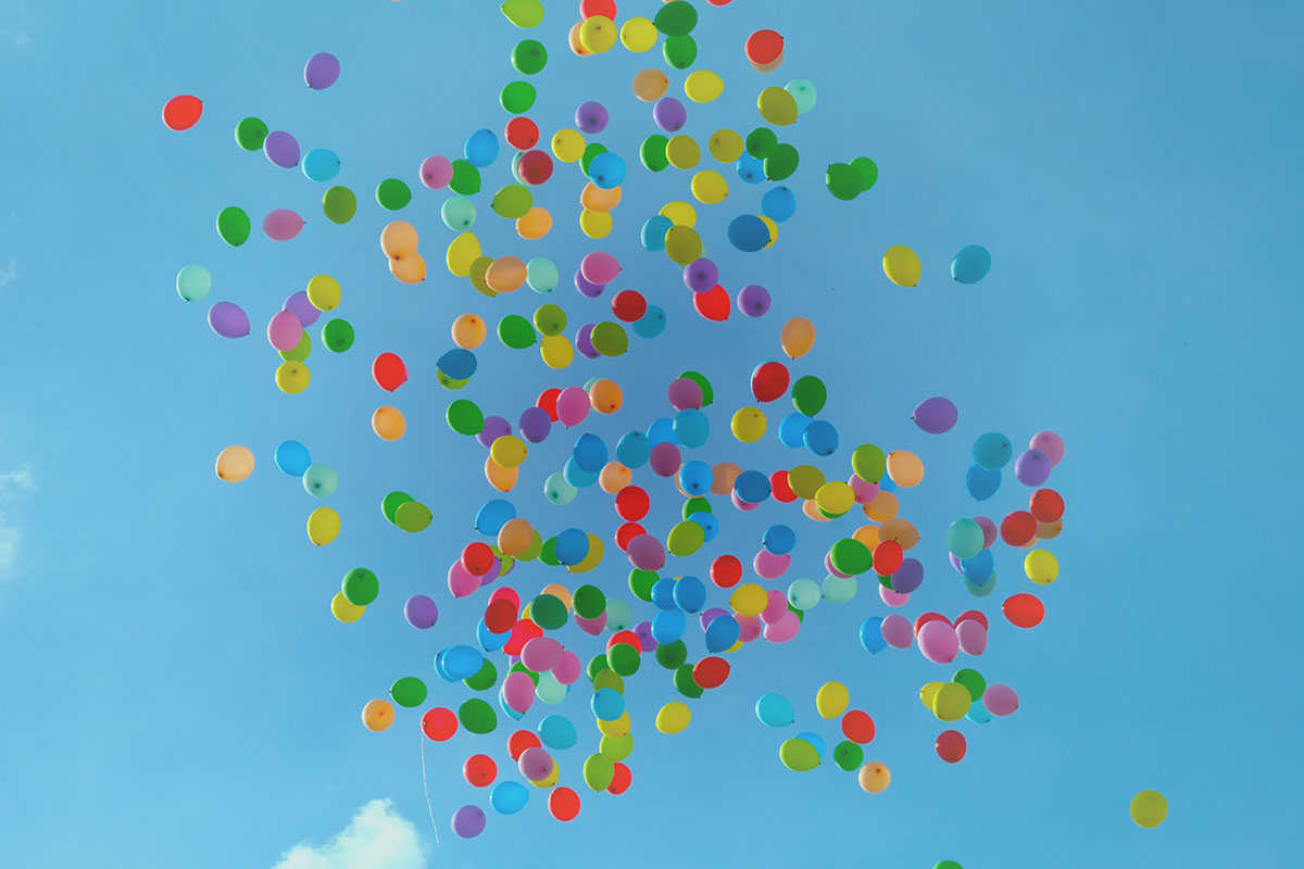 Colored balloons floating in the blue sky